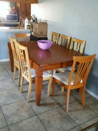 rectangular brown wooden table with six chairs dining set Riverside, 92509