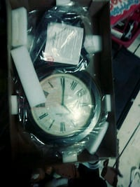 round silver-colored chronograph watch with black leather strap Harper Woods, 48225