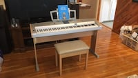 white and black electronic keyboard New York, 10308
