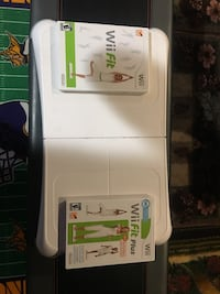 Wii fit board plus the game and another wii fit plus game