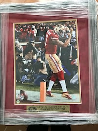 Colin kaepernick photo w/black frame. Certificate of authenticity incl