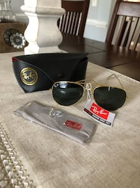 Brand New RayBan Aviators - gold frames with black lenses. These retail for $150. They come with the box, case and cleaning cloth. Leesburg, 20176