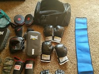 two pairs black-and-white Everlast boxing gloves