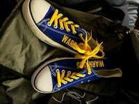 pair of blue-and-yellow low-top sneakers