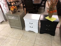 two white wooden 2-drawer nightstands Houston, 77041
