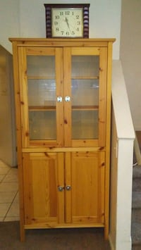 brown wooden framed glass cabinet 49 km