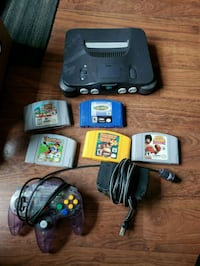 black Nintendo 64 console with controller and game cartridges Winnipeg, R2H 0R1