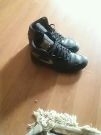 pair of black leather high-top sneakers Mississauga, L5K 1T7