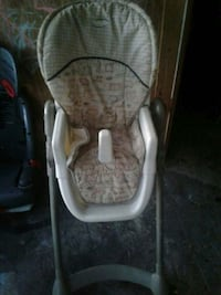 High chair lowers and higher as child grows  Winter Haven