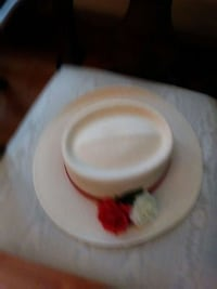 white and red ceramic bowl