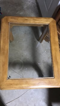 2 Brown wooden framed glass top coffee table North Port, 34286