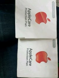 two white and red iTunes gift cards Calgary, T3G 5C8