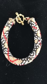 white, red, and grey beaded bracelet Chambly
