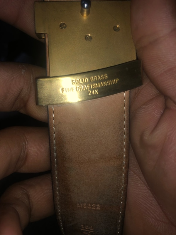 black and brown Louis Vuitton leather belt