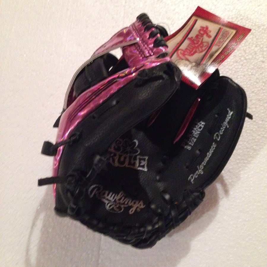 Black and pink leather baseball gloves..