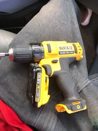 yellow and black DeWalt cordless power drill null