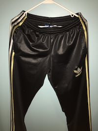 Black and yellow adidas track pants