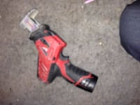 red and black cordless power tool Aurora, 80017