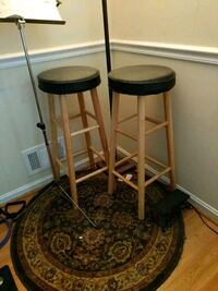 two black leather padded bar stools Rockville, 20853