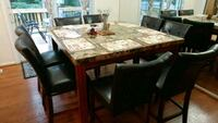 Luxury dining table with 8 high chairs.  Manassas