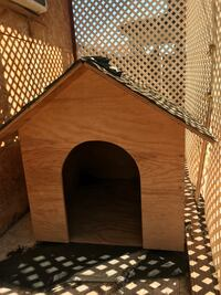 Brown and black wooden dog house