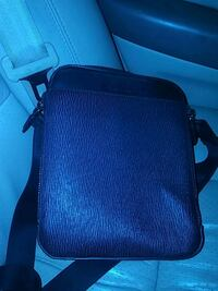 blue and black leather crossbody bag