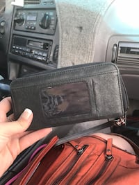 Black leather bi-fold wallet Missoula, 59803