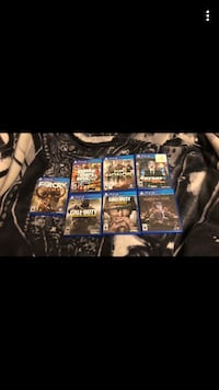 Black sony ps4 with games Lethbridge, T1K 5R2