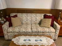 brown and gray floral fabric sofa