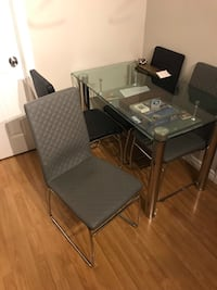 rectangular glass top table with four chairs dining set St Catharines, L2P 2N4