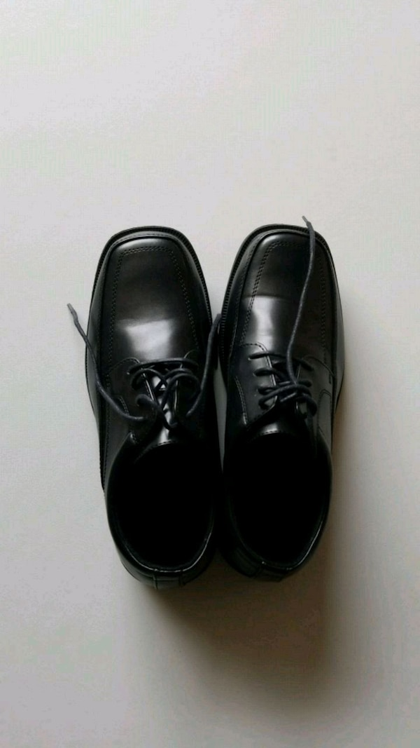 Mens pair of black leather dress shoes