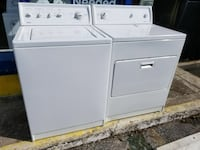 white top-load clothes washer and front-load clothes dryer Gainesville