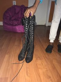 pair of black leather lace-up knee-high boots