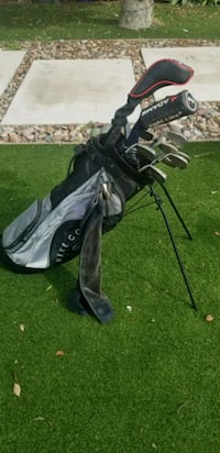 black and gray golf bag and clubs. Near New driver Lemon Grove, 91945