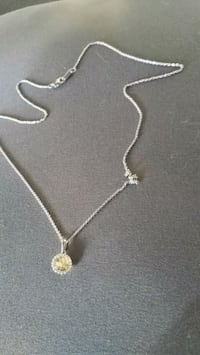 silver-colored necklace with pendant 1629 mi