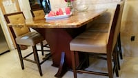 beige marble topped brown wooden based dinette set