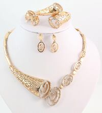 gold-colored necklace and earrings London, N6P 1T9
