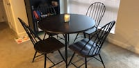 Round brown wooden table with four chairs dining set Silver Spring, 20902