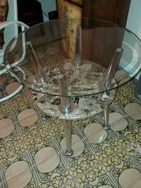 round clear glass top table with gray metal base Fort Lauderdale, 33315