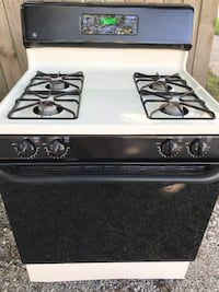 Off-white And black GE natural gas stove Fort Wayne, 46805