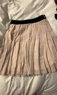 Pleated nude mini skirt