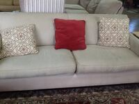Cream fabric 2-seat sofa with throw pillows Rockville, 20850