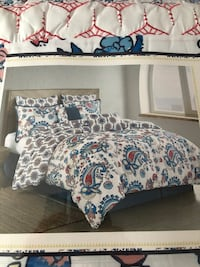 Brand new King 8 pieces reversible comforter set
