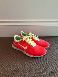 pair of red Nike low-top sneakers Vancouver, V6G 3J1