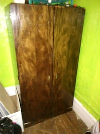 Vintage brown wooden 2-door cabinet