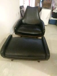 black leather padded rolling chair Fort Washington, 20744