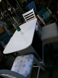 Small table with two stools into high chairs