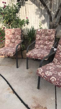 two brown wooden framed floral padded armchairs Bakersfield, 93306