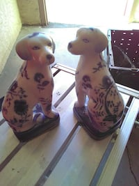 two white and blue ceramic dog decors