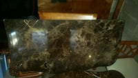 brown and black marble top table